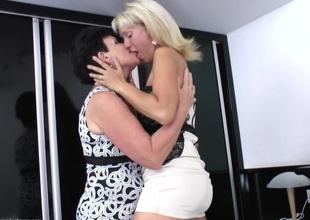 A pair of mature women eating each other's vintage pussies