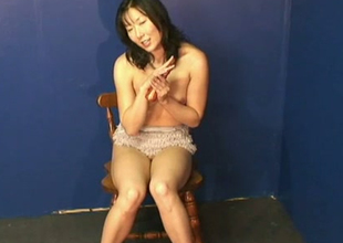 Korean amateur MILF slips smooth dildo in her sleek love tunnel hole