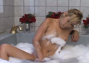 Stunning Oriental GF caressing new sexy body in the baths