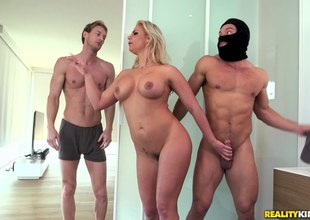 Curvy milf fucked by a burglar with her spouse in the bed