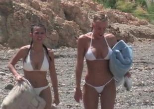 Bikini women with big tits have lesbian sex outdoors
