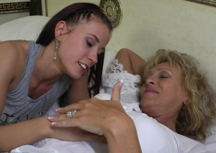 Super cute teen lesbo hooks up with a grandma and licks her
