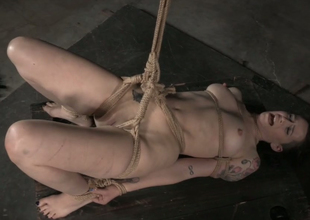 Big bottomed pallid brunette is fixed in extraordinary position by her master