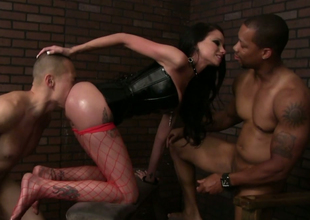 Hussy in fishnet stockings and corset Raven Bay is drilled by two guys
