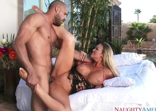 Abbey Brooks acquires a visit from her neighbor. He catches her in the garden as she's tanning. Her huge tits are staring at him. He acquires a blow job.