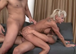 A hot milf is getting ass drilled during the time that she's giving a blow job. She can't live without to have sex in a trio since then all her holes get filled up at once.