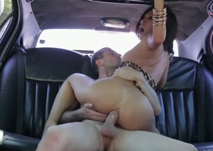 Hot woman is in the back of her car. She can stretch and bow her body in amazing ways. She is getting an anal gangbang and her pussy is being fingered in this video.