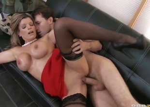 Milf really likes 'em big. This babe has huge boobs that she uses to rub big cocks. Her knockers are put to nice use in this fine video.