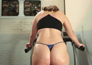 BBW Virgo Peridot with natural breasts and thick ass strips down to her thong panties in the gym. Chunky lady puts her overweight ass on show during the time that doing exercises. Shes proud of her ass