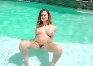 Wet babe Keisha Grey with huge tits and bushy twat poses naked by the pool and then plays with a lucky guys indoors. Bare busty chick has a good time sucking his sausage on the couch