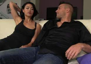 Black haired oriental MILF Dana Vespoli with perfect bubble butt is in the mood for anal sex. She gets her asshole licked and drilled by a hard penis on the couch in the living room