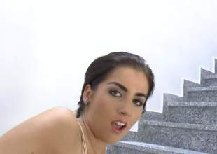 Playful dark brown Lauren Minaldy with big booty pulls her dark thong pants aside on the stairs and makes pink anal dildo disappear in her asshole. She toy fucks her butt from behind