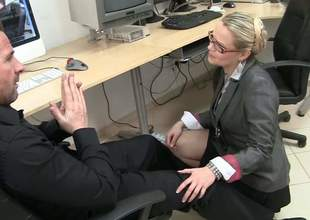 Blonde haired MILF with glasses Barra Brass acquires down on her knees in front of coworker and unbuttons her blouse. That babe has a nice time playing with his hard cock in the office