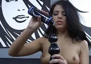 Brunette pornstar fucking both her holes with huge brutal dildos in HD