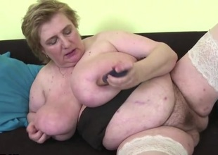 Naughty old plump chick fucks a toy into her cunt